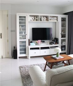 Ikea Hemnes- I like the stand itself but way too much busy-ness going on with all the crap surrounding the tv.: