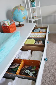 Use storage bins to keep drawers in the changing table/dresser organized! #nursery #organization