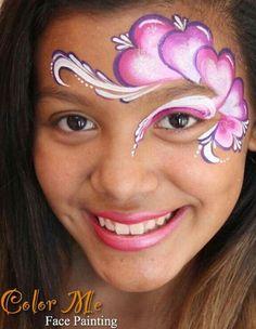 Simple heart eye swirl face paint