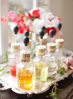 A unique idea! A custom perfume bar for guests to make their own scents.