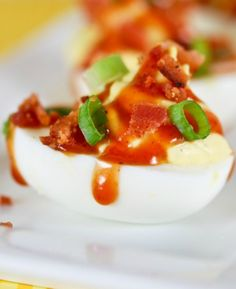 Our Barbecued Ranch Deviled Eggs Are Delicious Creamy Deviled Eggs Flavored With Ranch Dressing And Drizzled With BBQ Sauce And Bacon. The Flavor Trifecta! Huevos Rancheros, Omelettes, Appetizer Dips, Appetizer Recipes, Brunch Recipes, Egg Recipes, Easter Recipes, Recipies, Salsa