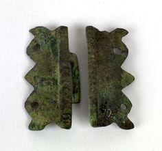 Complete pair of copper alloy sleeve/belt clasps. Excavated from Staxton Anglo-Saxon Cemetery, East Yorkshire, between 1937 and 1938.