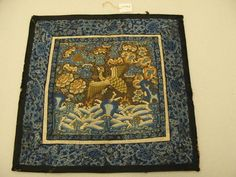 """This is a """"Mandarin square"""", the rank badge worn by a second-rank civil servant during the Qing dynasty in China (1664-1911).  The bird is called a golden pheasant."""