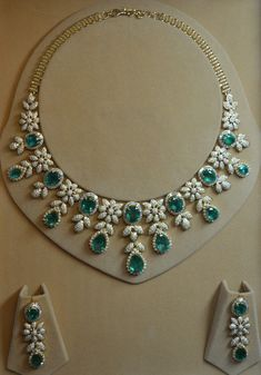 Bridal necklace set with diamonds & emeralds. DJNKCSEM 56