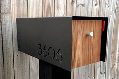 """Modern and Sleek Mailbox - David Grisham, co-owner of Nashville-based architecture firm and design lab Aesh Design. """"I saw it as a way to bring high-end design to an everyday market,"""" he says. The mailboxes are handmade by local fabricators and woodworkers and include a powder-coated aluminum base.  Price: $375 plus shipping. Wall-mounted $275. Optional upgrades of stainless steel base, larger size and door lock."""