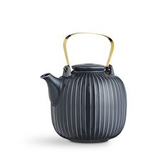 Hammershøi teapot anthracite   The beautiful Hammershøi teapots are designed with a delicate, brass-coated handle, which lends the familiar, well-loved Hammershøi design an exclusive touch. Use the anthracite teapot when you relax with your girlfriends over a delicious cup of tea or when inviting your family for afternoon tea. The Hammershøi teapot comes in two Nordic colours.