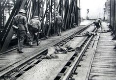 June 22 1941 and the first soldiers of a  Wehrmacht Division to cross a railway bridge into Przemysl, Russia, are killed by defending border guards.