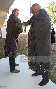 Prince Harry and King Letsie III of Lesotho wear shawls given to them as a gift as they attend the opening of Sentebale's Mamohato Children's Centre during an official visit to Africa on November 2015 in Maseru, Lesotho. Zulu Traditional Attire, Black King And Queen, Prince Harry Of Wales, Black Royalty, African Royalty, We The Kings, African Attire, Rey, African Fashion