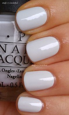 opi My Boyfriend Scales Walls is a lovely white creme with a few cool drops of grey