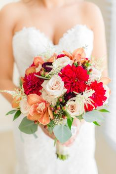 Orange, ivory and red bouquet for the bride with greenery | Fall wedding at Meadow Wood Manor in Randolph NJ | Classic fall wedding | NJ wedding | outdoor wedding | Navy and burgundy wedding | Florals by Sayrewoods Florist | Photos by NJ Wedding Photographers Idalia Photography