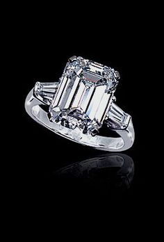 Graff Diamonds - White flawless emerald cut diamond ring set with white tapered baguette diamond shoulders. Perfection!!!!!