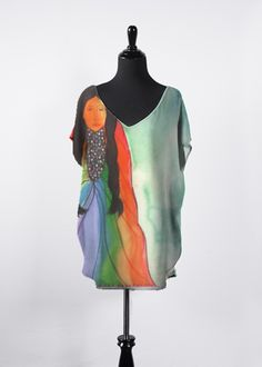 Artist Kelly @ MessiahsDisciple Green Corn Ceremony Essential Top beautiful, flowing top features dolman sleeves, a flattering V-neck and a hi-low silhouette. It will be your new go-to top this season and all year long! Pair it with your favorite tapered pants or skinny jeans for an effortless, day-to-night look.  $85 USD http://shopvida.com/collections/voices/products/green-corn-ceremony-top-1