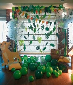 Baby Leo party candy bar Lion King theme 1st birthday party boy  photobooth backdrop jungle leaves balloons sweets table cupcake gingerbread cake pops Simba