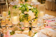 Crystal storm lanterns and tea lights help to create a stunning table centrepiece. props.wildatheart.com