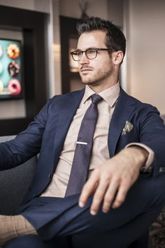 smart look: shorter trouser and blazer, thinner notched lapel, slim tie, tie bar, tortoise frame ray bans