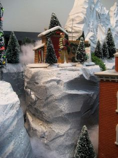 Styrofoam Village Displays   Here stands the tall figure of J. Wellington Peak,