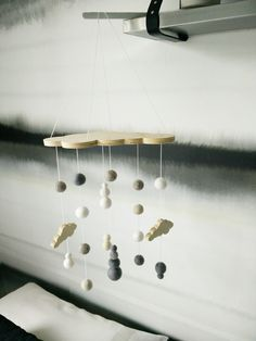 A beautiful collaboration between Felt that and Decor Handled.A cloud shaped ply header plate with cascades of gorgeous soft felt balls, crochet balls and baby clouds.Available in three col...