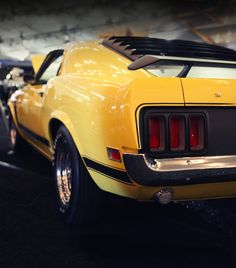 1970 Ford Mustang Boss 302 Fastback. Black & Yellow. 4-speed manual transmission.
