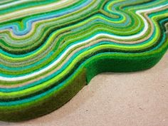 DIY felt rug....take strips of felt and glue them together in curvy shapes