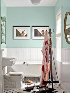 Tiffany blue livens up the walls in this bright bathroom. Pretty, huh? #bathroomdecor