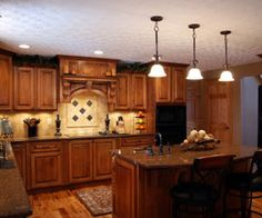 Kitchen Design Black Appliances a large country kitchen with knotty alder cabinetscabinets have