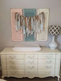 Farmhouse-inspired nursery   What a perfect set up for a changing area. The shutters would be so easy to DIY!