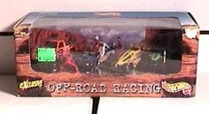 Hot Wheels - Exclusive Off-Road Racing Set (4 Vehicles) by Mattel. Inc.. $10.00. Also included are three miniature figures (crew).. Includes an orange high-rise pickup truck, green dune buggy, a sport utility vehicle and an all-terrain vehicle.. Hot Wheels - Exclusive Off-Road Racing Set - 4 vehicles