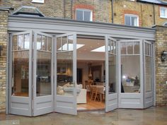 Let the outside in with our beautifully made timber sliding folding doors also known as bi-fold doors. Porch Windows, House Windows, Windows And Doors, Bi Folding Doors Kitchen, Kitchen Extension French Doors, Orangerie Extension, Stacking Doors, Garden Room Extensions, House Extension Design