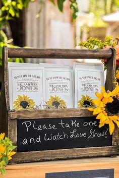 Sunflower seed wedding favors! Like this idea too...just like wheel barrel.