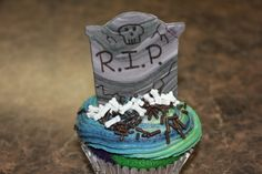 Halloween Cupcake ~ Tombstone Marbled fondant tombstone painted with food color pens, candy bones, variegated butter-cream frosting