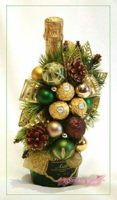 DIY Ferrero Rocher Gift Ideas – Edible Crafts This round up shows you creative ways to gift Ferrero Rocher chocolates. We have covered how to make trees, Christmas tree's cakes and even Ferrero Rocher Angels. Wine Bottle Gift, Wine Bottle Crafts, Wine Gifts, Christmas Wine, Christmas Candy, Diy Christmas Gifts, Reindeer Christmas, Christmas Trees, Candy Crafts
