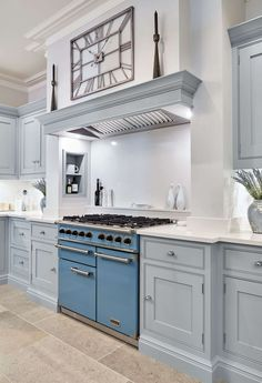 This stunning light blue kitchen features state of the art appliances. Both the cabinetry and beautiful island are painted in our very own Iris. Kitchen Cabinets Uk, Blue Gray Kitchen Cabinets, Painted Kitchen Island, Blue Kitchen Island, Blue Kitchen Decor, Bar Kitchen, Kitchen Ideas, Light Blue Kitchens, Grey Kitchens