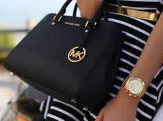 J'aime beaucoup la marque Michael Kors, très chic et propose beaucoup de références en terme de bijoux, sacs, montres.
