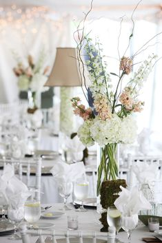 ? blush colored stock, white hydrangeas, and white delphinium.  (curly willow doesn't have to be added.)  This is very simple and elegant all at the same time.  These are in the cylinder vases, but can be put in any vase.