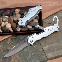 "Both trendy and timeless, our personalized Pocket Knife with Light makes a fabulous gift for everyone from college buddies and groomsmen to co-workers and friends. Handy for all occasions, this stainless steel pocket tool features a 3"" knife blade, fold out LED light, spring loaded carabiner clip and anodized construction. Add free personalization, and this handsome knife becomes an instant keepsake to every person receiving it.    Details:  Size: Measures 4"" by 1 1/4 inches wide."
