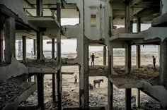 The Year in Pictures 2015 - The New York Times - BEIT LAHIYA, GAZA 8/3/2015 People looked for concrete to salvage in a building destroyed by the 2014 war between Israel and Palestinian militants in Gaza. Tomas Munita for The New York Times