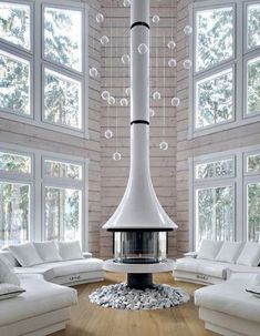 Je ne sais pas vous mais ce matin il fait un peu froid. La neige est attendue. La féerie d'un chalet, de la neige et une cheminée au centre pour se réchauffer. Modèle Eva 992 By Jc Bordelet. À retrouver sur www.bordelet.com  #interieur #decoration #design #feu #cheminée #stoves #fireplaces #salon #livingroom #douceur #flamme #bois #plaisir #architecte #decorateur Metal Fireplace, Fireplace Lighting, Christmas Fireplace Decor, Interior, Glass Fireplace, New Home Wishes, Home Deco, Indoor Fireplace, Suspended Fireplace