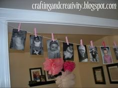 year of photos with pink clothes pins cute idea! Of course I'd switch it up with some blues and greens :)