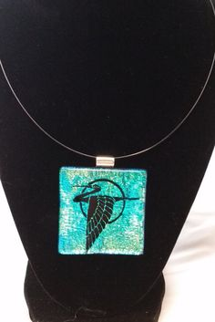 Dazzling large dichroic glass pendant necklace with large crane flying across a green and gold dichroic sky. Includes magnetic clasp choker by Fondredeverre on Etsy