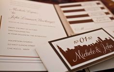 CT Designs Chicago-themed invitations; Sand metallic pockets with natural belly band and slender enclosure cards