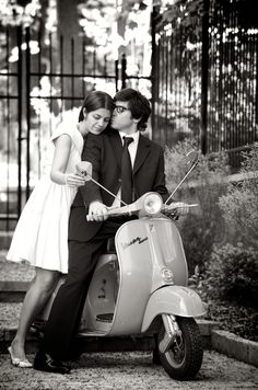 Black & white photograph of couple on engagement shoot with a Vespa.