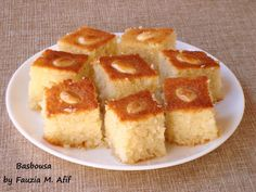 Basbousa (also known as Revani, Hareesa and Nammoura in various places) is a traditional Middle Eastern sweet moist cake, usually made with semolina and soaked in a simple syrup. Love this stuff! Arabic Sweets, Arabic Food, Sweet Recipes, Cake Recipes, Dessert Recipes, Basbusa Recipe, Algerian Recipes, Algerian Food, Aloe Vera