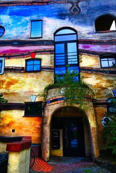 Hunderwasser desighned this apartment house in Vienna, Austria. lt has toilet like gadgets inside the windows, when pulled it waters all the plants that are growing outside of the windows.... also a lovely garden on the roof...Anyone could write on the walls or paint whatever they want.... the kids playroom has uneven floor, wavelike.