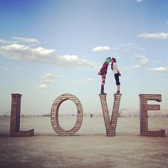 Photo by @missjessrose | Black Rock City is for lovers. Laura Kimpton and Jeff Schomberg's 2007 art installation makes that easy to see. | #burningman #brc #blackrockcity #love #bigart #playalove