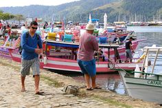 Boatman and Pedestrian - Paraty - Brazil, via Flickr.