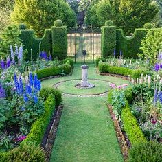 The Sundial Garden was the first garden that Prince Charles renovated and reworked to his own vision. Here, it is lush with deep blue, purple, and pink delphinium, the large flower spikes supported by single bamboo stakes.