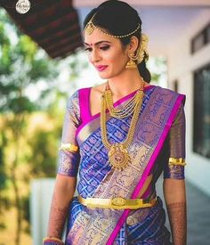 South Indian bride. Gold Indian bridal jewelry.Temple jewelry. Jhumkis.Blue and pink silk kanchipuram sari.Braid with fresh jasmine flowers. Tamil bride. Telugu bride. Kannada bride. Hindu bride. Malayalee bride.Kerala bride.South Indian wedding. Pinterest: @deepa8