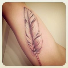 Feather tatto i want to get half in my hair behind my ear.