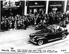 King George VI and Queen Elizabeth pass the Toronto Star building and look at their picture over the doorway (nice touch). Toronto, 1939.