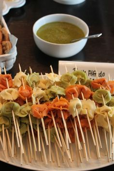 How adorable are these pasta skewers?  Simply cook the tortellini according to package directions, thread through a skewer and dip into a fresh basil sauce.  Perfect for any dinner party!